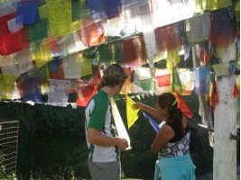 Palmo explaining the prayer flags to us